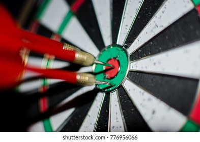Wooden Dart Board with Aroows on it