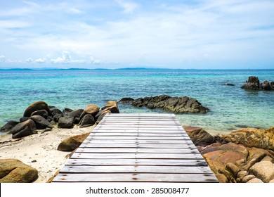Wooden deck, wooden bridge , Tropical beach in Munnork island, Rayong, Thailand