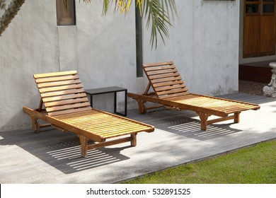 Wooden deck chairs on the green grass