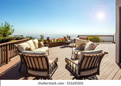Wooden Deck at daytime with seating arrangement
