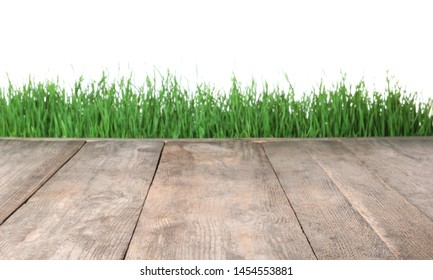Wooden deck and green grass isolated on white