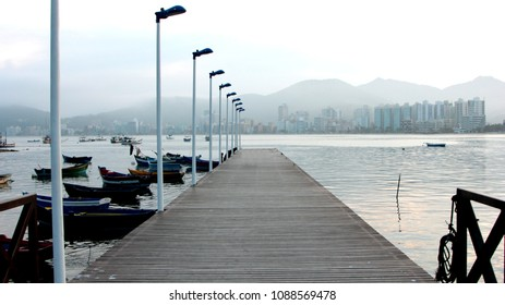 Wooden deck, ocean and buildings on Itapema, Santa Catarina, Brazil.