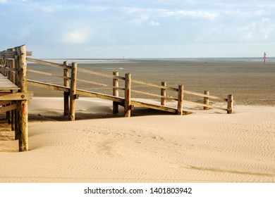 wooden deck in the sand by the ocean