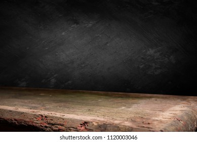 Wooden deck table on grey grunge background