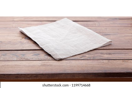 Wooden deck table with tablecloth isolated on white. Kitchen background, product montage display. Mock up.