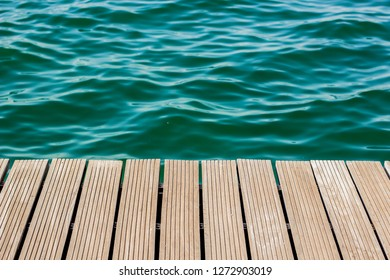 wooden deck waterfront outdoor exterior floor perspective background texture and sea water surface wallpaper pattern with empty space for copy or your text