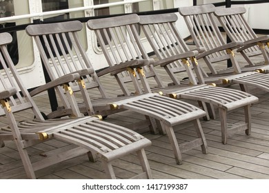 Wooden deckchairs on a ship
