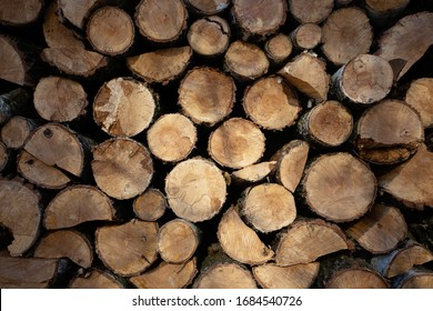 wooden decks are stacked for cutting for firewood