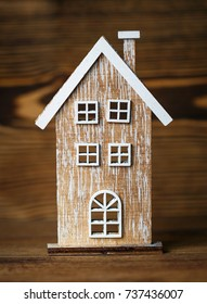 Wooden decorative house on rustic style wooden background