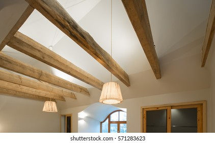 Wooden design. Wooden beams and floor to ceiling as a design element. Modern interior.