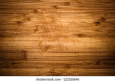 Wooden desk background with vignette. Wood background. Desk marks after using as a kitchen desk.
