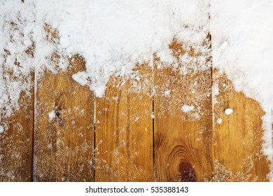 Wooden desk covered by snow