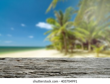 Wooden desk. Empty table on beach background with palms