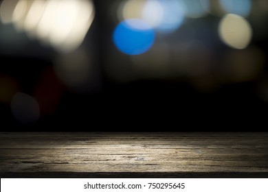 Wooden desk or wooden floor on bokeh background. Empty wooden desk to present and show product