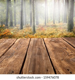 wooden desk and forest with fog