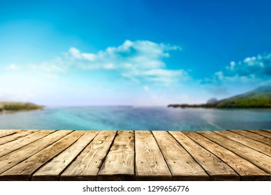 Wooden desk of free space and summer landscape of sea and sky