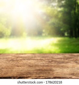 wooden desk and garden background with empty space