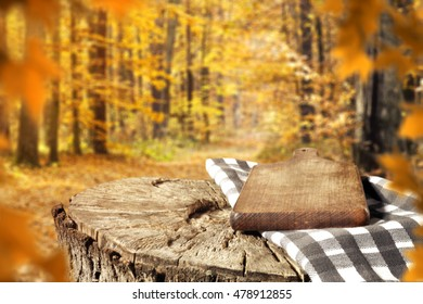 wooden desk space and autumn forest of golden colors