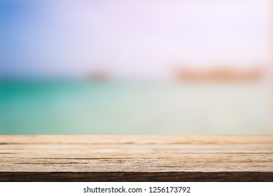 Wooden desk space over summer sea side sunny day background. Product display montage.
