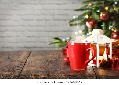 wooden desk space red mug and xmas tree