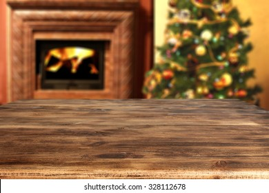 wooden desk space and xmas tree and fireplace