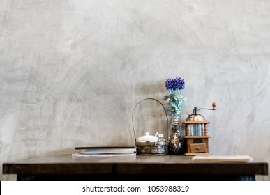 Wooden desk table at wall in coffee cafe interior with copy space.