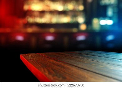 wooden desk top of free space for your decoration and party light of red and blue color