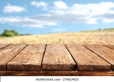 wooden desk top and sky