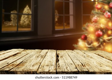 wooden desk and xmas tree in home