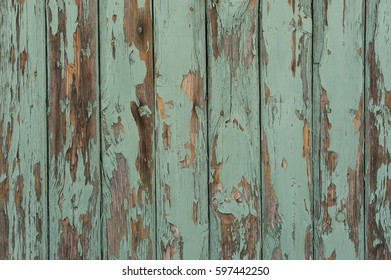 Wooden desks covered with green peeling paint texture