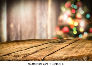 wooden destroyed table by the Christmas tree