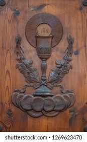 Wooden details of the entrance door, convent of San Francesco Roman Catholic church in Gothic style, Colle di Val d'Elsa, Siena, Tuscany