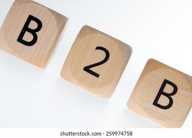 wooden dice with the abbreviation B2B / B2B