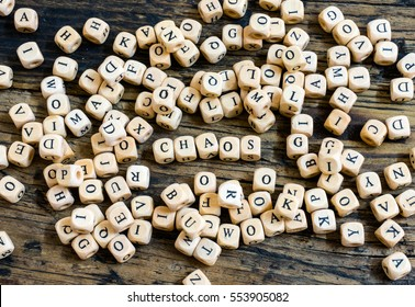 wooden dice in disarray and chaos with the word chaos in the middle