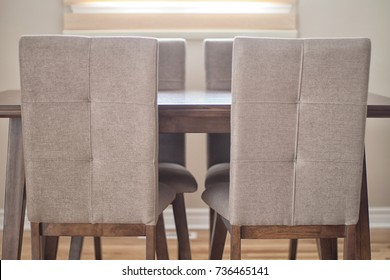 Wooden dining table and chairs for family of four