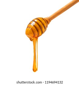 Wooden dipper with  Honey pouring and glass jar isolated on white background. Organic bee products.