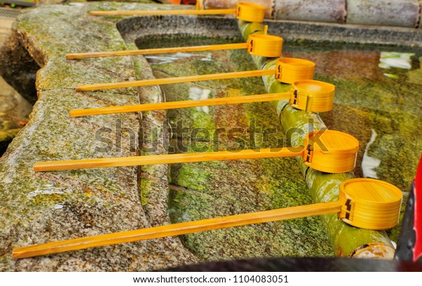 Wooden Dipper use to get shinto water ablution pavilion in Water-filled basins call chozubachi in japanese ,for purify the body before visiting a shrine to worship ,that call in Japanese temizuya.