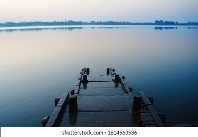 Wooden dock for boats at peaceful morning at Datta River, Pakhiralay town, Sundarban National Park, West Bengal, India
