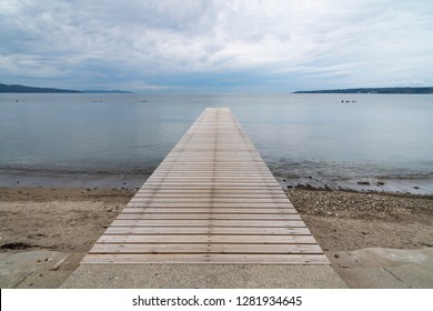 Wooden dock extending to the sea