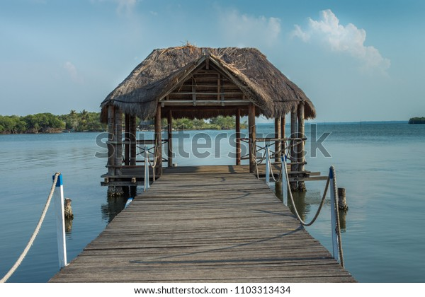 Wooden dock house over a lagoon with blue sky in summer