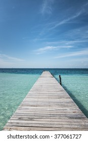 wooden dock into blue tropical sea in Isla Mujeres, Yucatan Mexico