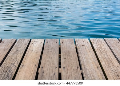 wooden dock and lake
