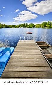 Wooden dock on beautiful summer lake in Ontario Canada