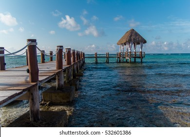 A wooden dock on the Caribbean Sea in Mexico, Yucatan. Waves
