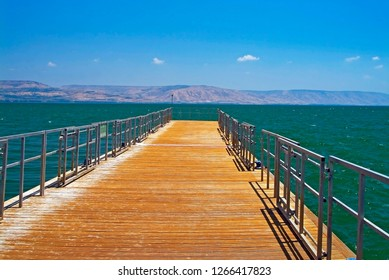 Wooden dock on Cineret Sea in a good weather