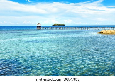 Wooden Dock on Togean Islands or Togian Islands in the Gulf of Tomini. Central Sulawesi. Indonesia