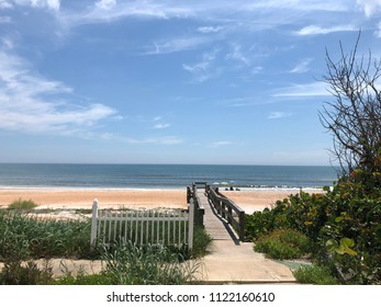 Wooden dock over the lush dunes on the beach in Florida