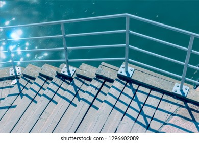 wooden dock with railing by the water in stockholm