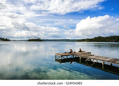 Wooden Dock in the Reflective Blue Lake Peten Itza in Flores, Guatemala