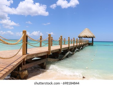 Wooden dock and shore at the Bayahibe beach, Dominican Republic